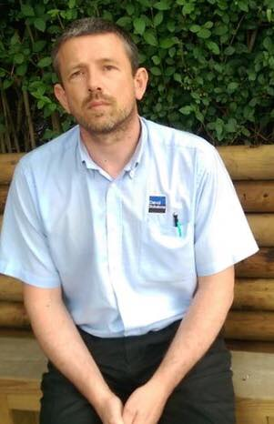 This is Paul Ponting from Danoli Solutions Ormskirk wearing his company shirt and posing for a picture for one of the local newspapers.